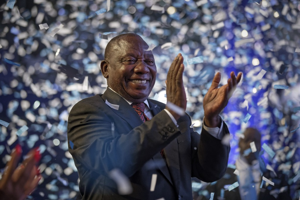 FILE - In this Saturday, May 11, 2019 file photo, President Cyril Ramaphosa applauds as confetti is launched at the end of the election results ceremo...