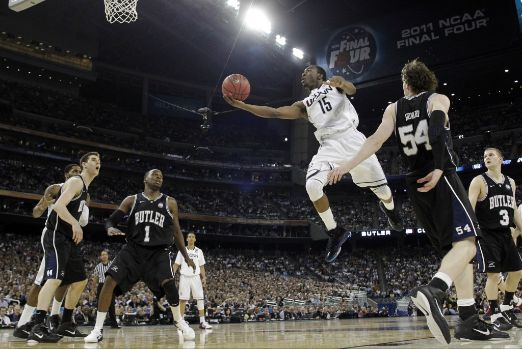 FILE- In this April 4, 2011, file photo, Connecticut's Kemba Walker (15) shoots against Butler during the second half of the men's NCAA Final Four col...