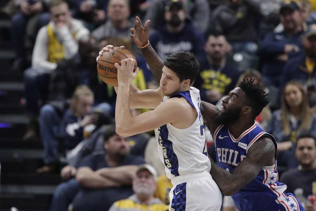Indiana Pacers' Doug McDermott (20) grabs a rebound against Philadelphia 76ers' Norvel Pelle (14) during the first half of an NBA basketball game, Tue...