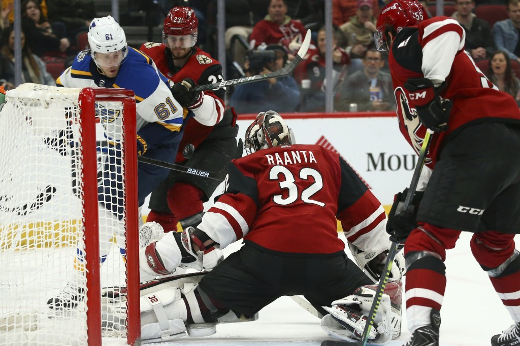 St. Louis Blues left wing Jacob de la Rose (61) tries to get his stick on the puck after Arizona Coyotes goaltender Antti Raanta (32) makes a save as ...