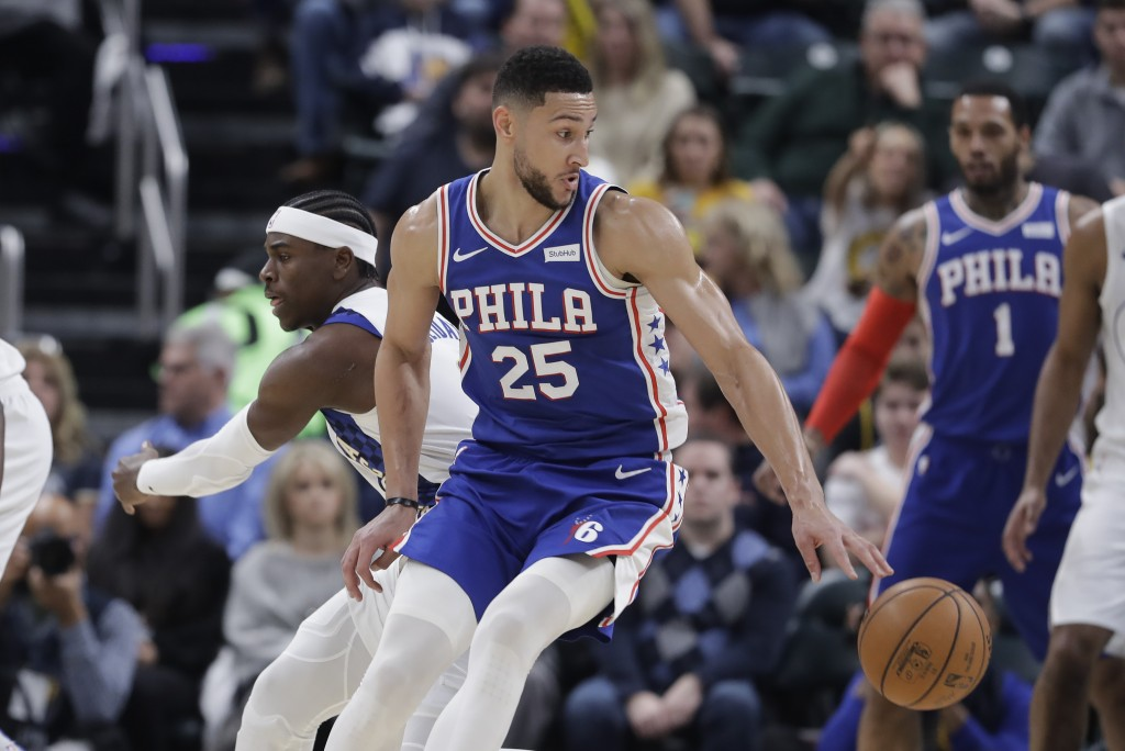 Philadelphia 76ers' Ben Simmons (25) makes a move against Indiana Pacers' Aaron Holiday (3) during the first half of an NBA basketball game, Tuesday, ...