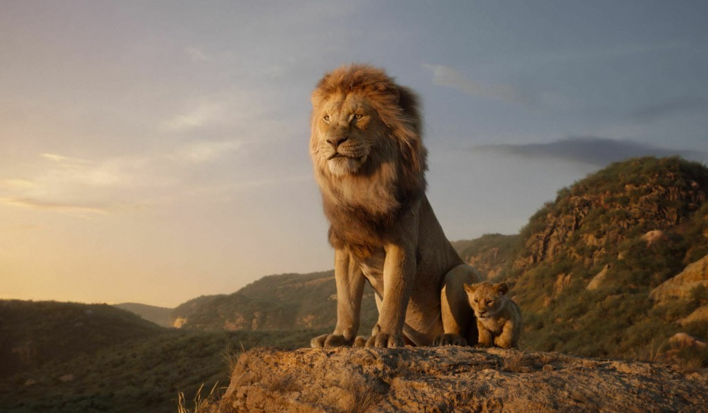 This image released by Disney shows characters, from left, Mufasa, voiced by James Earl Jones, and young Simba, voiced by JD McCrary, in a scene from ...