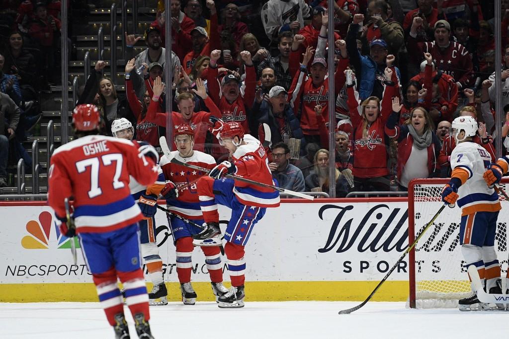 Washington Capitals center Evgeny Kuznetsov (92) celebrates his goal as New York Islanders right wing Jordan Eberle (7) looks on during the first peri...