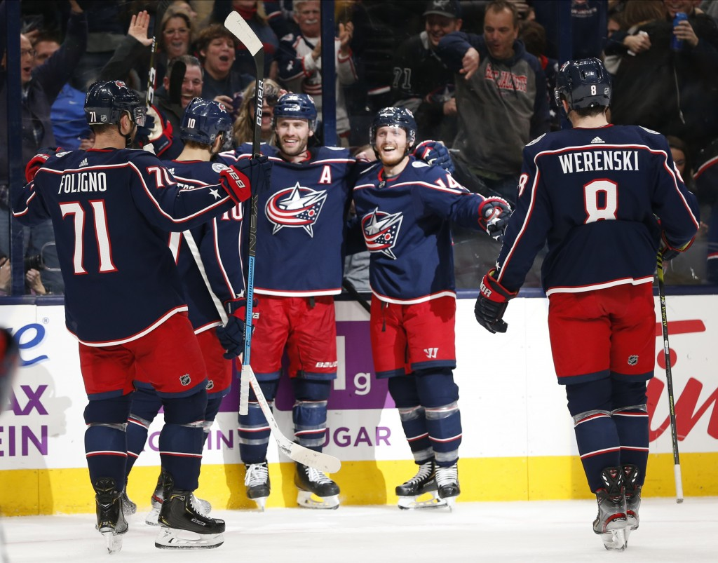 Columbus Blue Jackets' Boone Jenner, center, celebrates his goal against the Florida Panthers during the second period of an NHL hockey game Tuesday, ...
