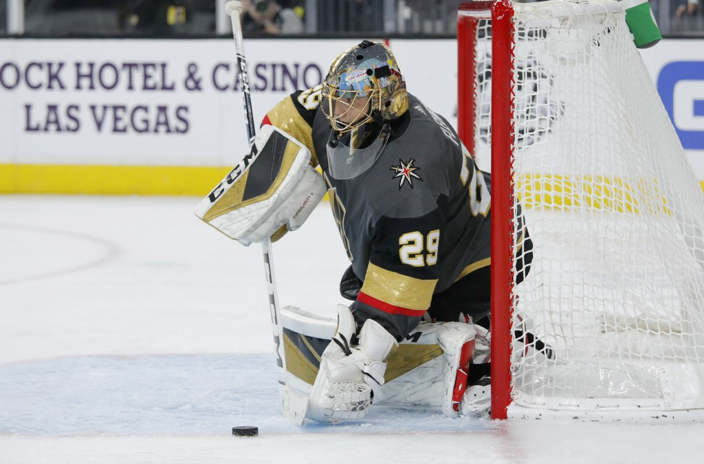 Vegas Golden Knights goaltender Marc-Andre Fleury (29) stops the puck against the Anaheim Ducks during the third period of an NHL hockey game Tuesday,...