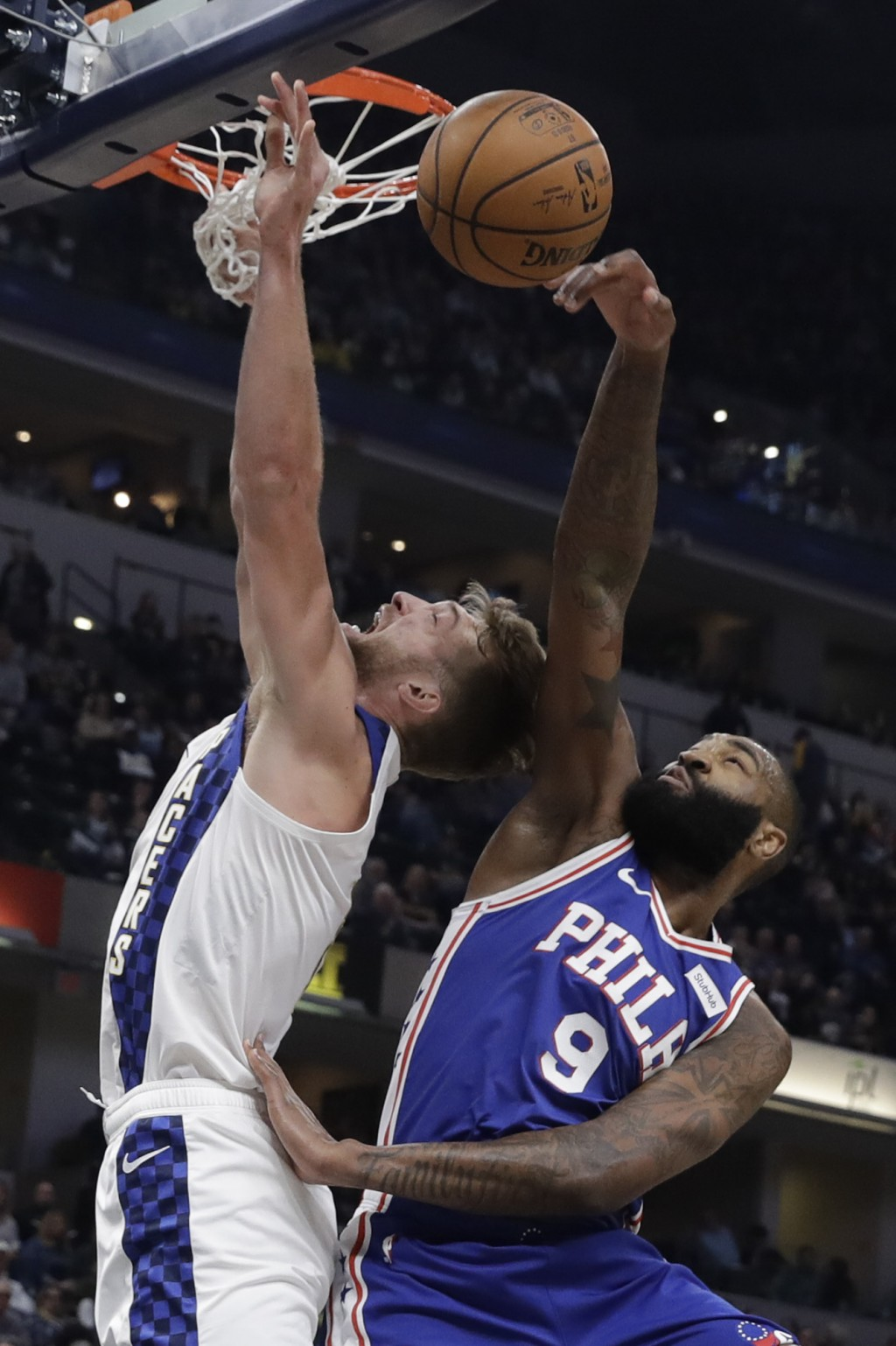 Indiana Pacers' Domantas Sabonis (11) has his shot blocked by Philadelphia 76ers' Kyle O'Quinn (9) during the first half of an NBA basketball game, Tu...