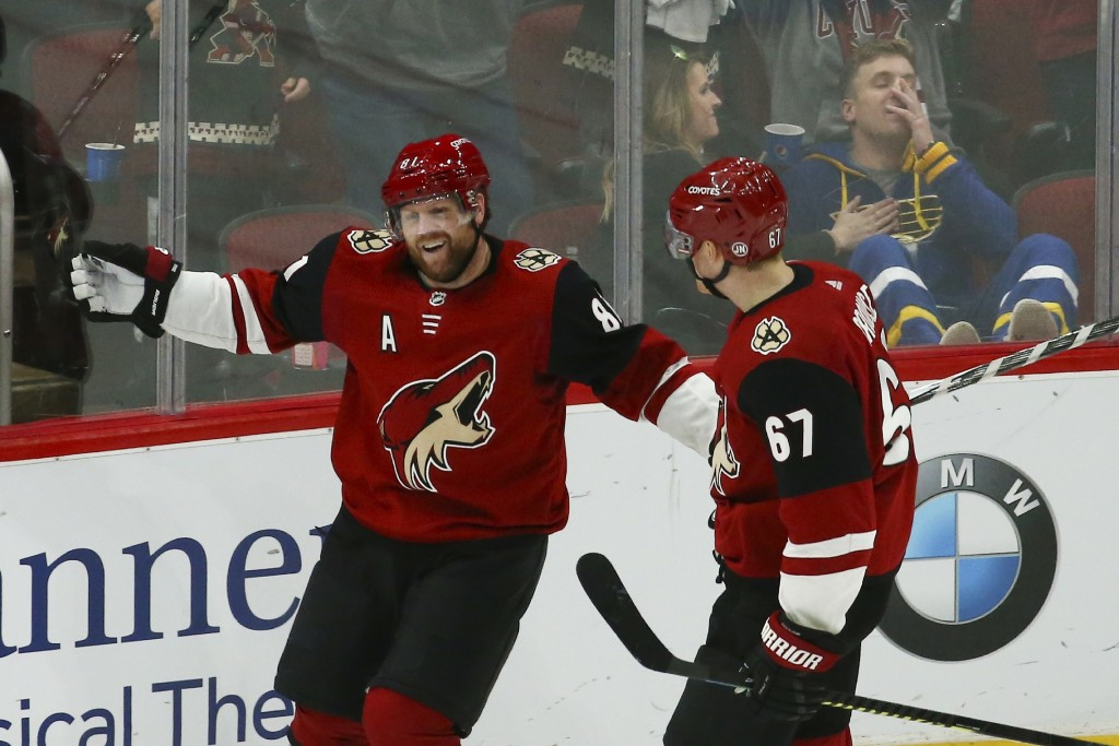 Arizona Coyotes right wing Phil Kessel (81) celebrates his goal against the St. Louis Blues with Coyotes left wing Lawson Crouse (67) during the third...