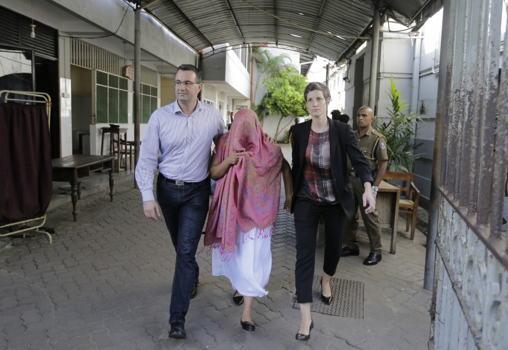 FILE- In this Monday, Dec. 30, 2019 file photo, a Swiss Embassy employee who was detained pending charges that she made statements to create disaffect...