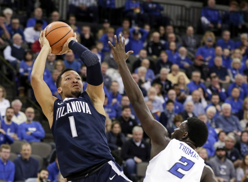 FILE- In this Feb. 24, 2018, file photo, Villanova's Jalen Brunson (1) shoots over Creighton's Khyri Thomas (2) during the first half of an NCAA colle...