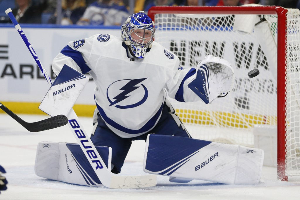 Tampa Bay Lightning goalie Andrei Vasilevskiy watches the puck during the third period of the team's NHL hockey game against the Buffalo Sabres, Tuesd...
