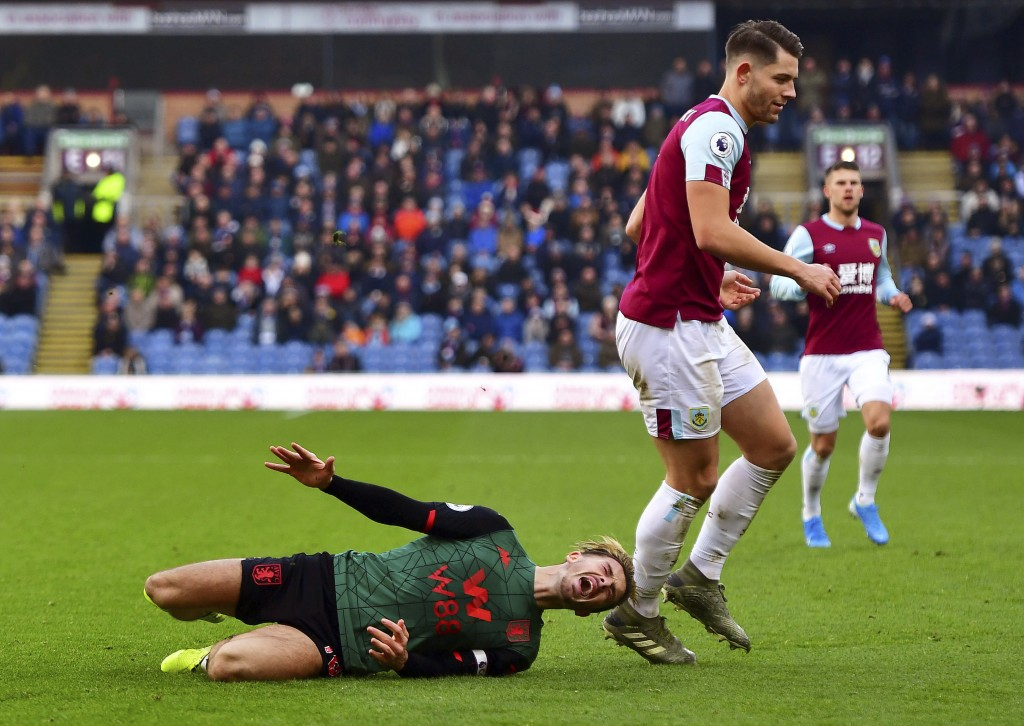 Burnley's James Tarkowski, right, collides with Aston Villa's Jack Grealish and receives a yellow card, during the English Premier League soccer match...