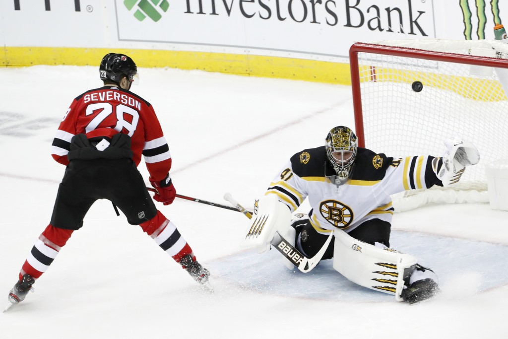 New Jersey Devils defenseman Damon Severson (28) gets his shot past Boston Bruins goaltender Jaroslav Halak (41) for a goal and the victory in a shoot...