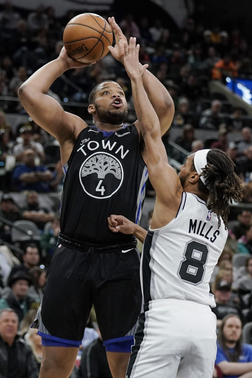 Golden State Warriors' Omari Spellman (4) shoots against San Antonio Spurs' Patty Mills during the first half of an NBA basketball game, Tuesday, Dec....