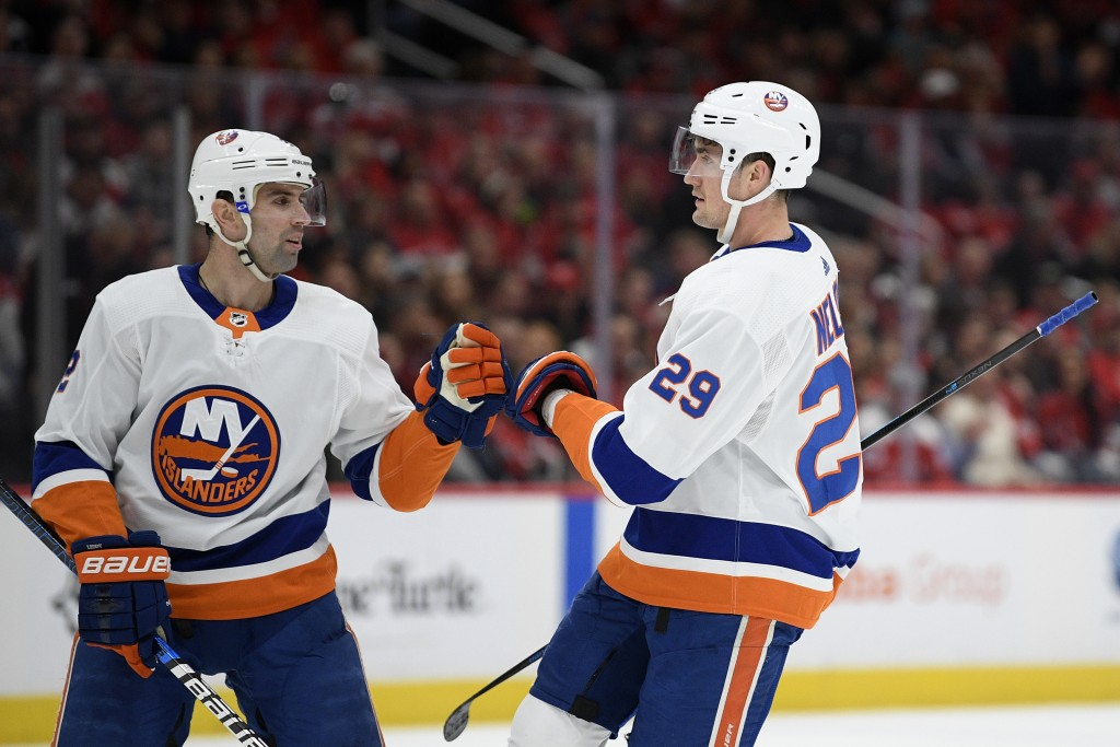 New York Islanders center Brock Nelson (29) celebrates his goal with defenseman Nick Leddy (2) during the first period of an NHL hockey game against t...