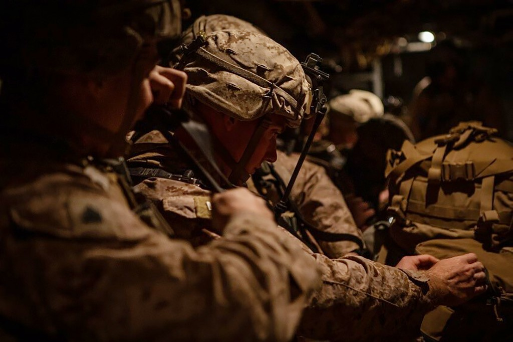 In this photo provided by U.S. Department of Defense, U.S. Marines assigned to Special Purpose Marine Air-Ground Task Force-Crisis Response-Central Co...