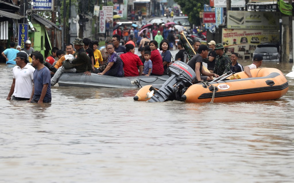 Indonesia rescue team evacuate residents from their flooded house at Jatibening out skirt of Jakarta, Indonesia, Wednesday, Jan. 1, 2020. Severe flood...