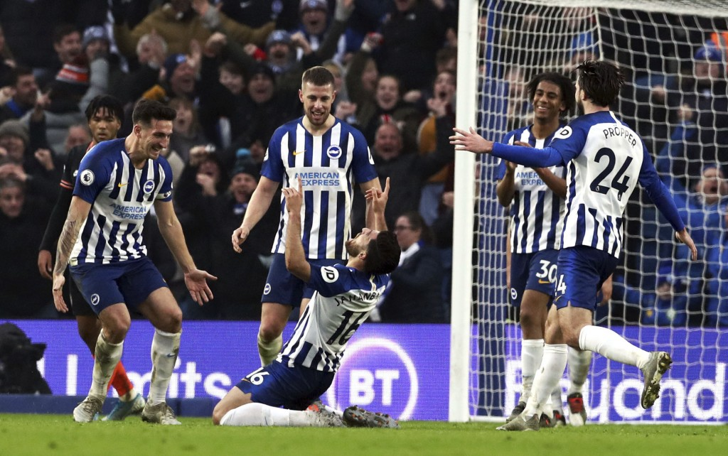 Brighton's Alireza Jahanbakhsh, centre, celebrates scoring his side's first goal of the game, during the English Premier League soccer match between B...