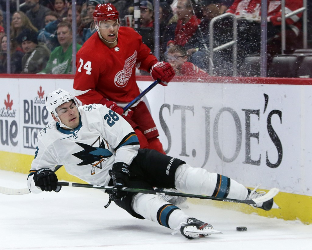 San Jose Sharks right wing Timo Meier (28), of Switzerland, looses his footing against Detroit Red Wings defenseman Madison Bowey (74) during the firs...