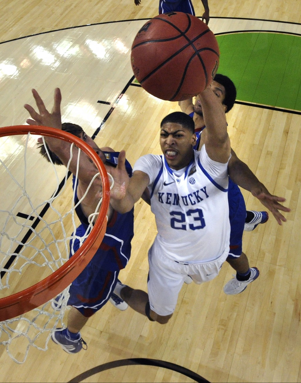 FILE- In this April 2, 2012, file photo, Kentucky forward Anthony Davis (23) drives to the basket in front of Kansas center Jeff Withey, left, and for...