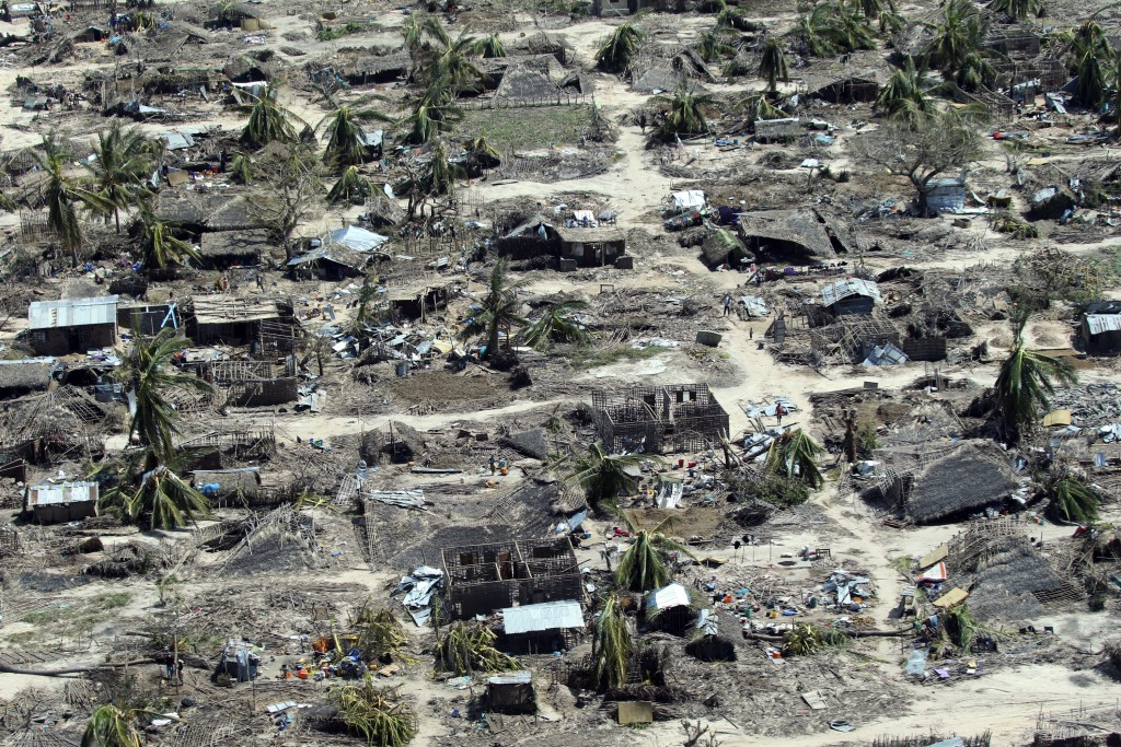 FILE - In this Wednesday, May, 1, 2019 file photo, widespread destruction caused by Cyclone Kenneth, which arrived just six weeks after Cyclone Idai, ...