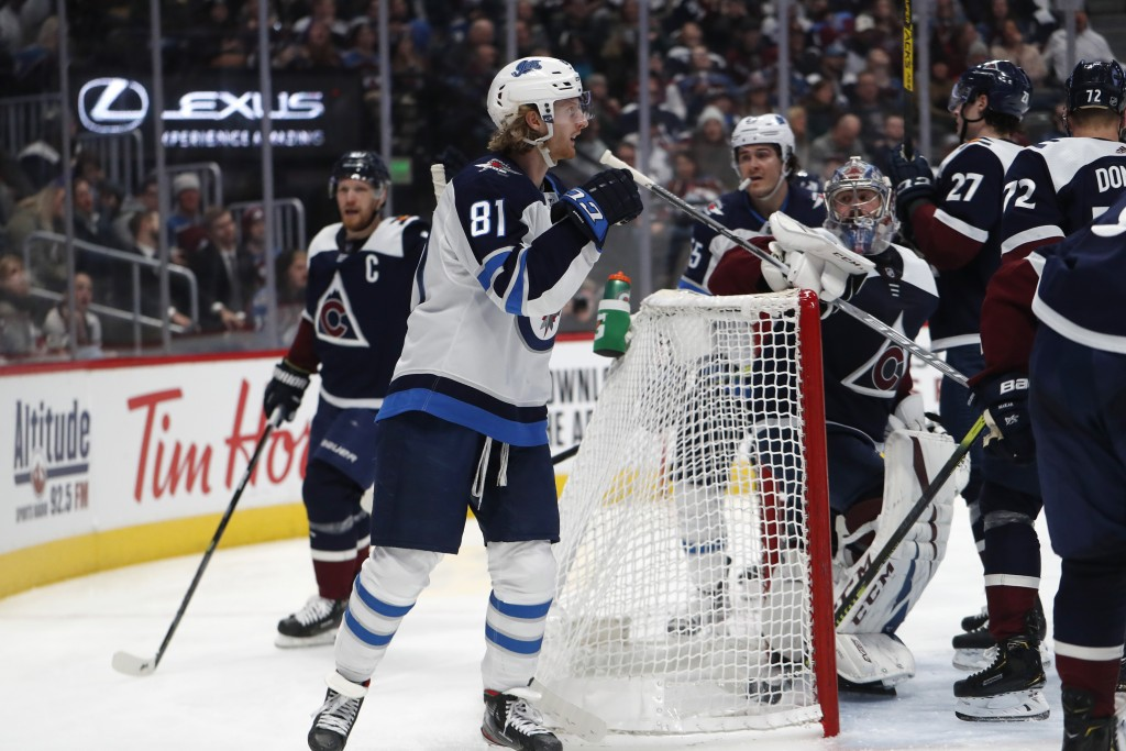 Winnipeg Jets left wing Kyle Connor reacts after scoring a goal against the Colorado Avalanche during the second period of an NHL hockey game Tuesday,...