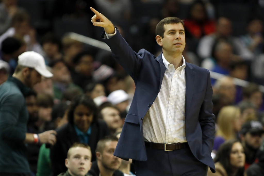 Boston Celtics' head coach Brad Stevens points the way from the sidelines against the Charlotte Hornets during the first half of an NBA basketball gam...
