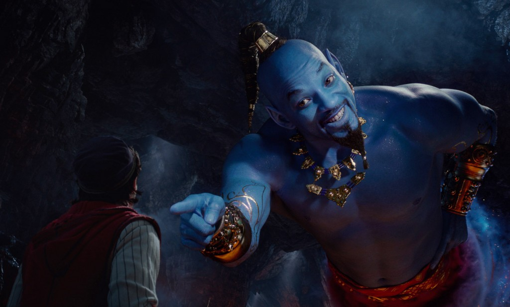 This image released by Disney shows Mena Massoud as Aladdin, left, and Will Smith as Genie in Disney's live-action adaptation of the 1992 animated cla...