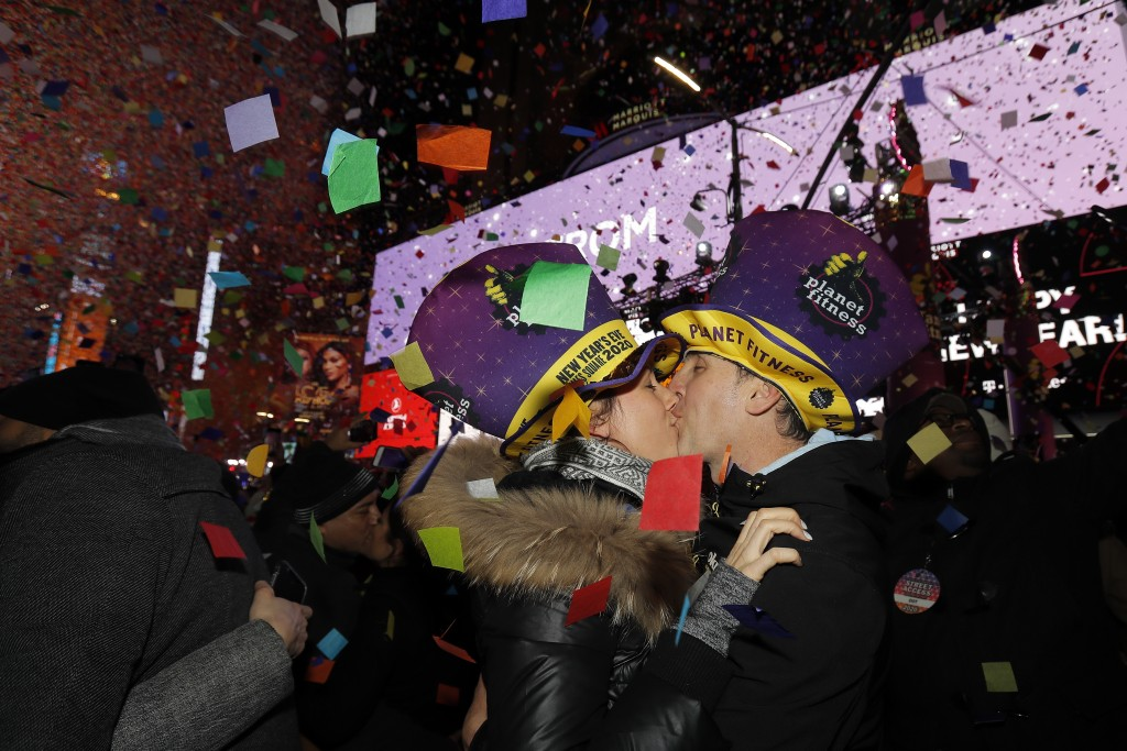 Sandra Desjardins kisses Jean-Charles Goulet both of Montreal, Canada, during a New Year's celebration in New York's Times Square, Wednesday, Jan. 1, ...