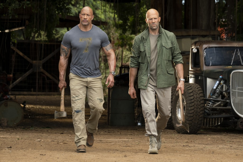 """This image released by Universal Pictures shows Dwayne Johnson, left, and Jason Statham in a scene from """"Fast & Furious Presents: Hobbs & Shaw.""""  (Fra..."""