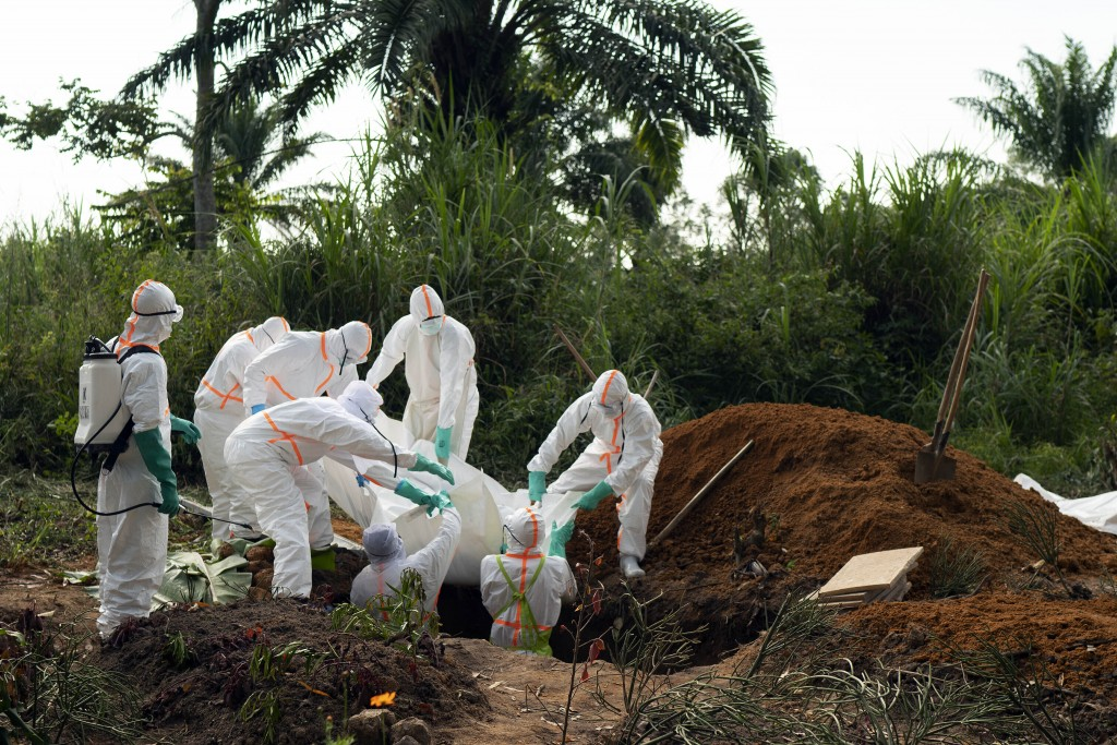 FILE - In this Sunday, July 14, 2019 file photo, an Ebola victim is put to rest at the Muslim cemetery in Beni, Congo. These African stories captured ...