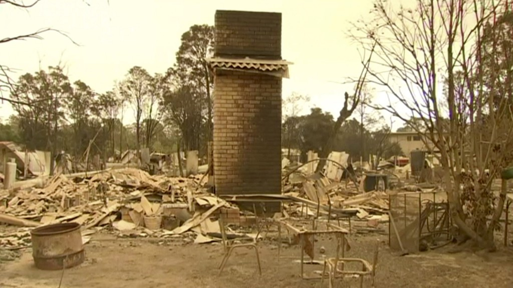This image made from video shows burnt house with garden chair after a wildfire in Mallacoota, Victoria, Wednesday, Jan. 1, 2020. Australia deployed m...