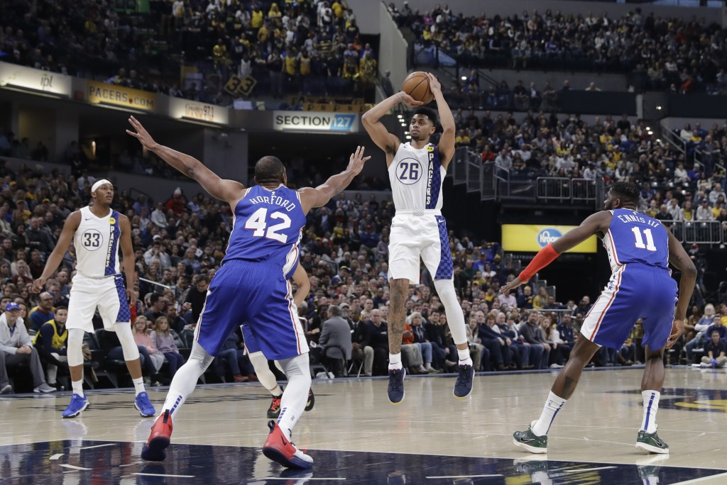 Indiana Pacers' Jeremy Lamb (26) puts up a shot against Philadelphia 76ers' Al Horford (42) during the first half of an NBA basketball game, Tuesday, ...