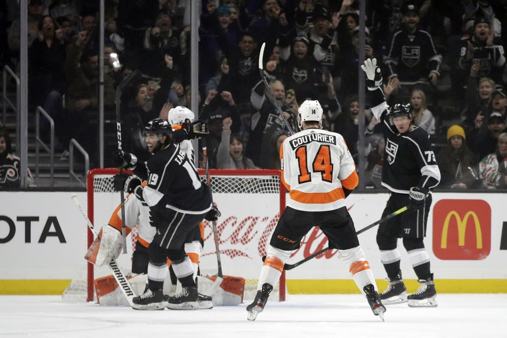 Los Angeles Kings' Alex Iafallo (19) celebrates after scoring against the Philadelphia Flyers during the first period of an NHL hockey game Tuesday, D...