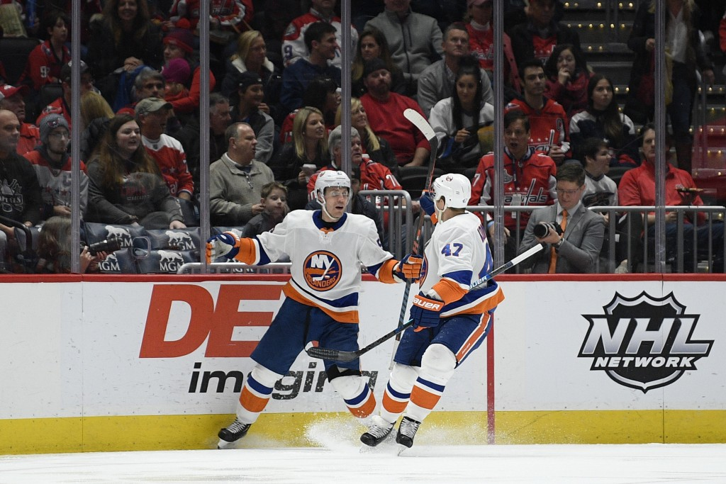 New York Islanders center Casey Cizikas, left, celebrates his goal with right wing Leo Komarov (47) during the second period of an NHL hockey game aga...