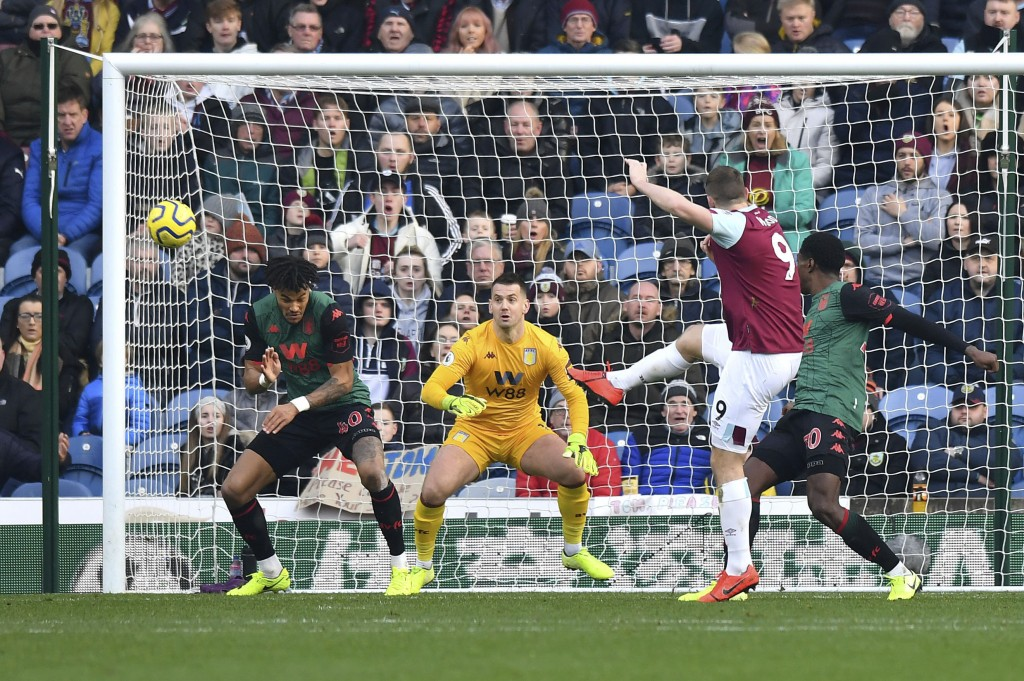 Burnley's Chris Wood, second left, shoots towards goal, during the English Premier League soccer match between Burnley and Aston Villa, at Turf Moor, ...