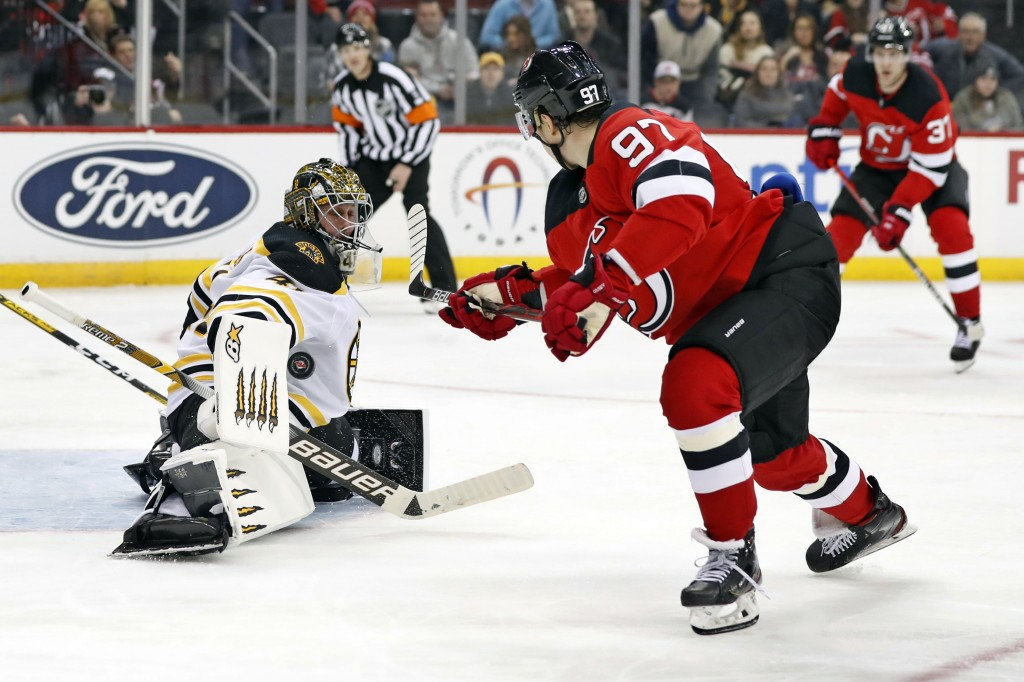 Boston Bruins goaltender Jaroslav Halak (41) blocks a shot by New Jersey Devils left wing Nikita Gusev (97) during the second period of an NHL hockey ...