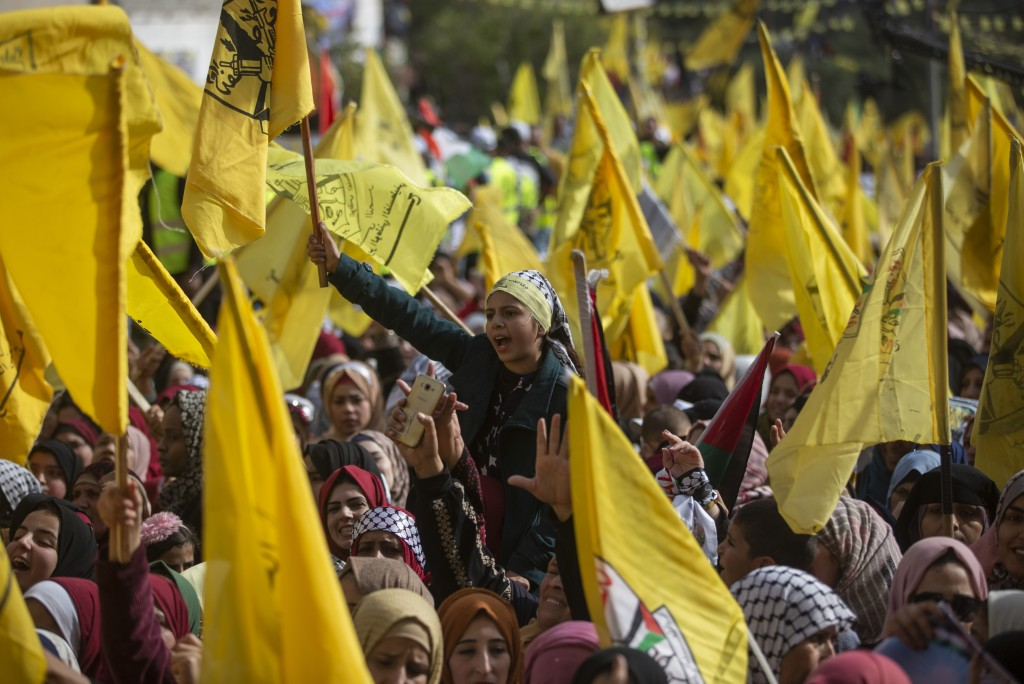 Palestinians wave yellow Fatah flags during a rally marking the 55th anniversary of the Fatah movement founding, in Gaza City, Wednesday, Jan. 1, 2020...