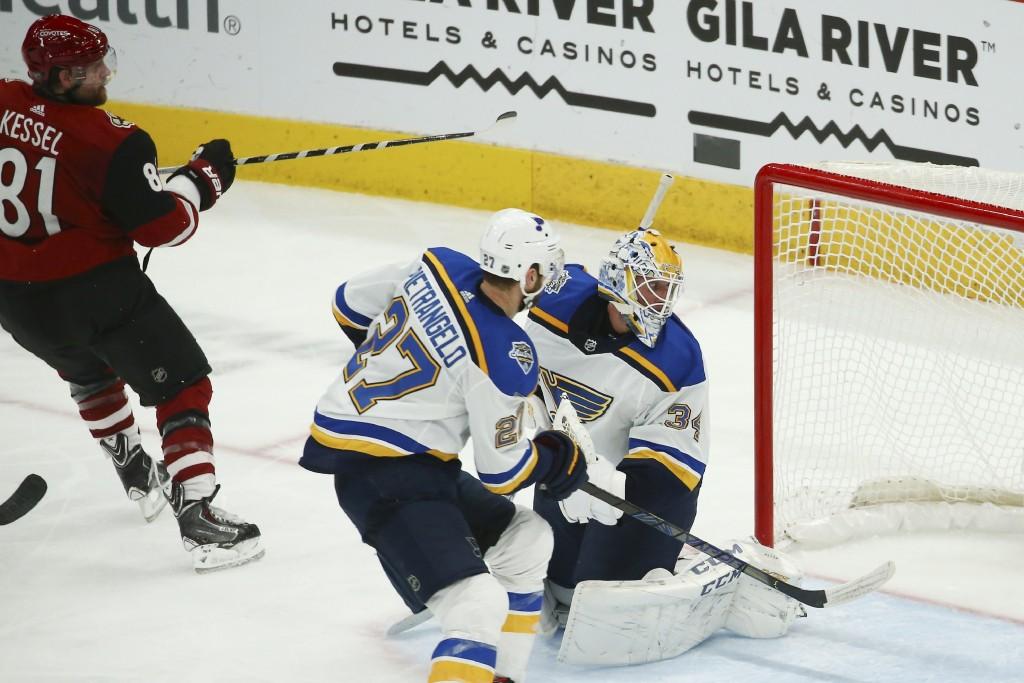 Arizona Coyotes right wing Phil Kessel (81) gets the puck past St. Louis Blues goaltender Jake Allen (34) and Blues defenseman Alex Pietrangelo (27) f...