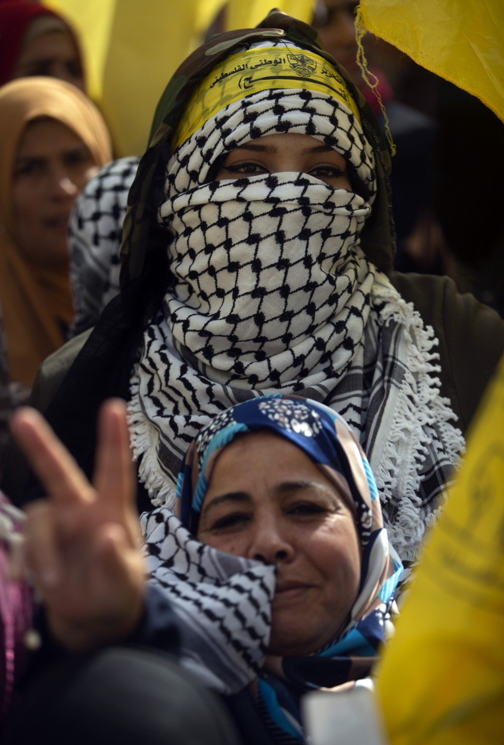 Palestinian women celebrate during a rally marking the 55th anniversary of the Fatah movement founding, in Gaza City, Wednesday, Jan. 1, 2020. Fatah i...