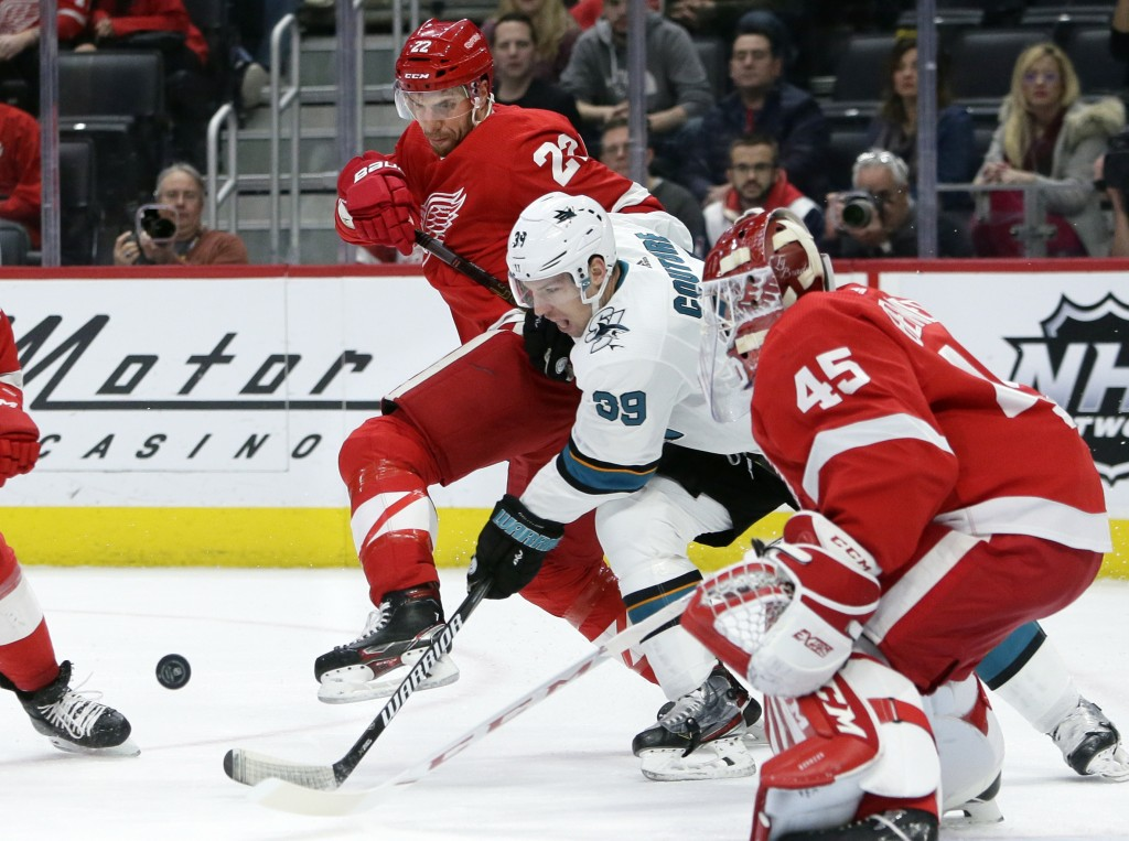 Detroit Red Wings defenseman Patrik Nemeth (22), of Sweden, and San Jose Sharks center Logan Couture (39) battle for the puck in front of Red Wings go...