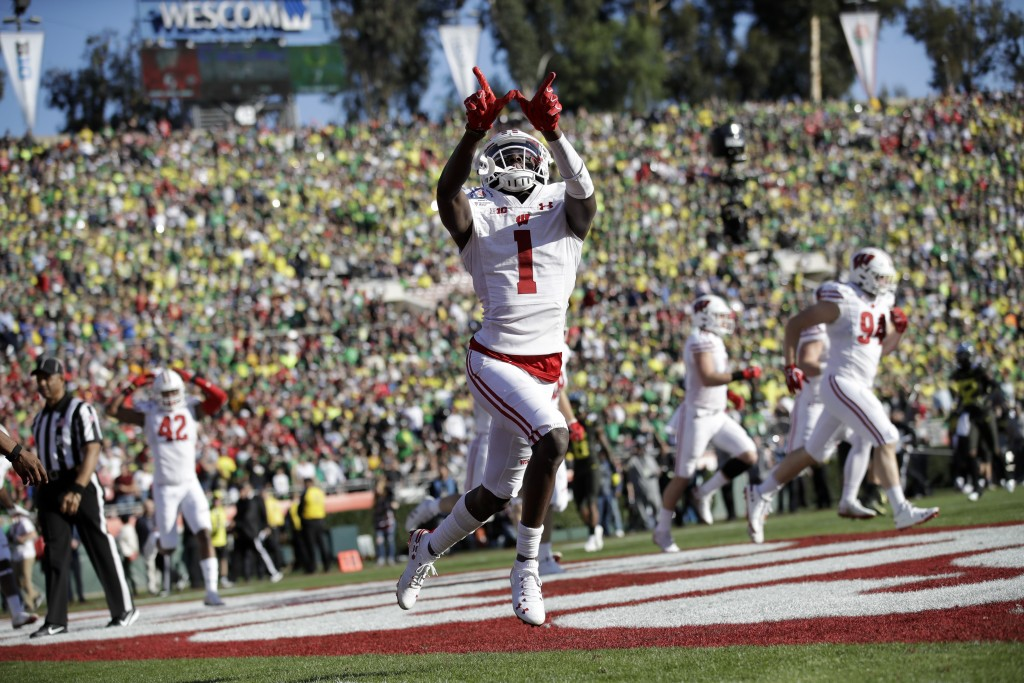 Wisconsin wide receiver Aron Cruickshank celebrates after scoring against Oregon during first half of the Rose Bowl NCAA college football game Wednesd...