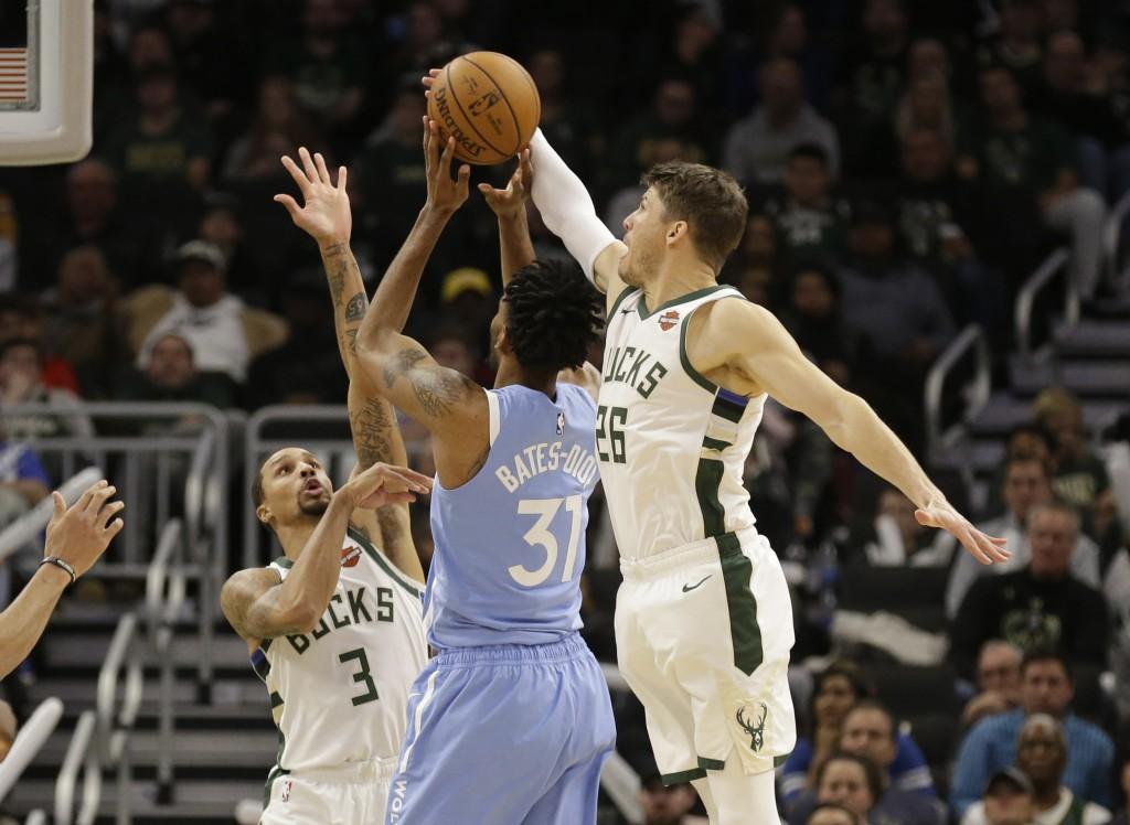 Milwaukee Bucks' Kyle Korver (26) blocks the shot of Minnesota Timberwolves' Keita Bates-Diop during the second half of an NBA basketball game Wednesd...
