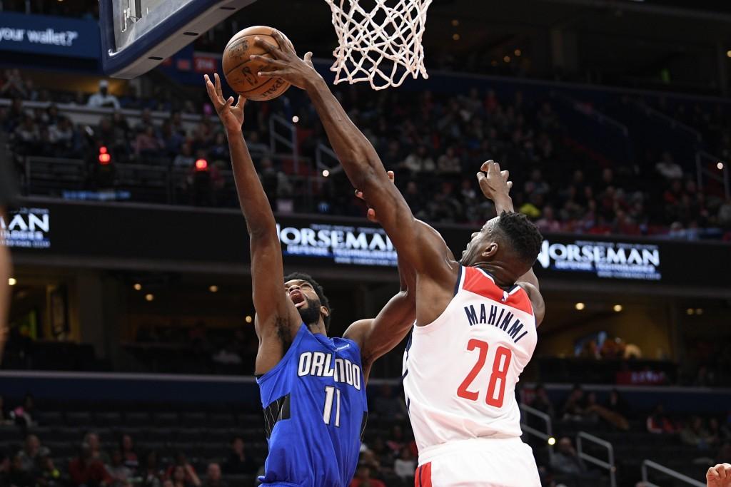 Orlando Magic forward Amile Jefferson (11) goes to the basket next to Washington Wizards center Ian Mahinmi (28) during the first half of an NBA baske...