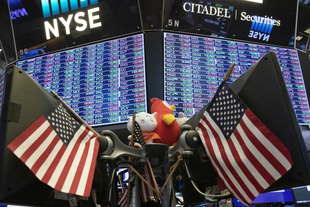 FILE - In this Sept. 18, 2019, file photo, stock prices are displayed at the New York Stock Exchange. Funds of all types made money through 2019, from...