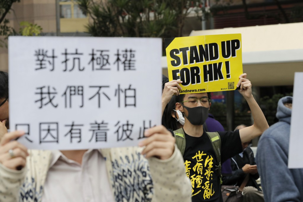 Protesters hold up banners during a rally in Hong Kong Thursday, Jan. 2, 2020. Hundreds of thousands of people packed Hong Kong streets for an annual ...