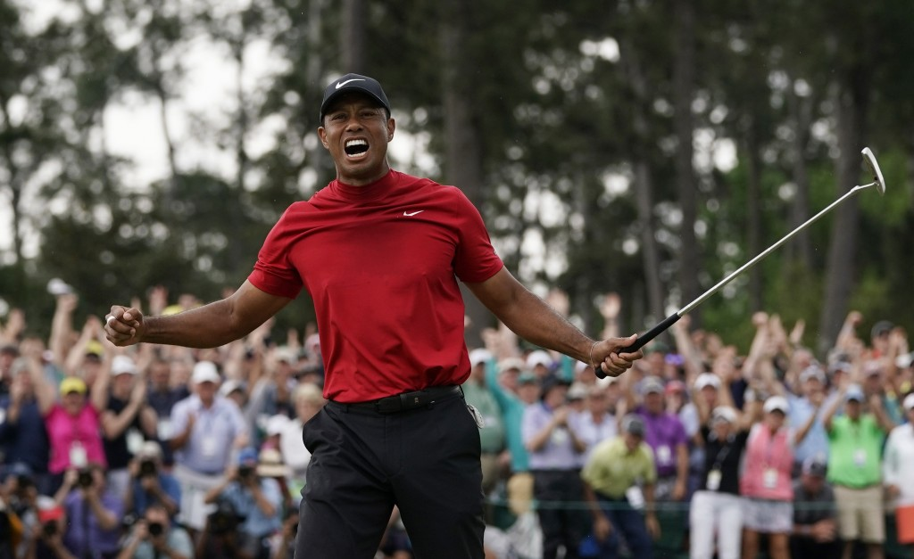 FILE - In this April 14, 2019, file photo, Tiger Woods reacts as he wins the Masters golf tournament in Augusta, Ga. His victory raises hope that he c...