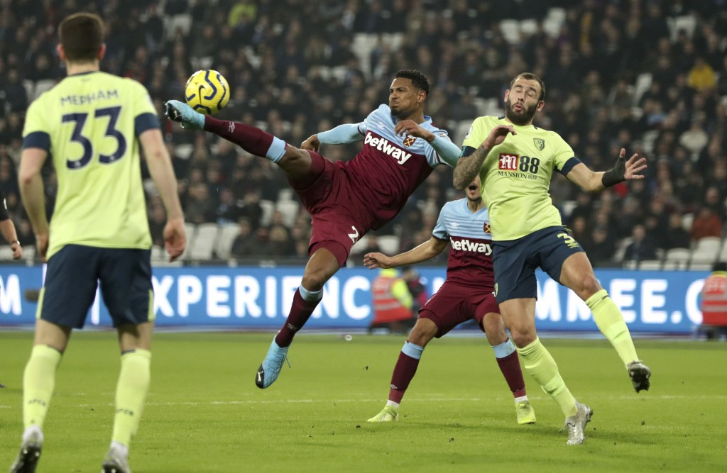 West Ham United's Sebastien Haller, centre left, reaches out to score his side's second goal of the game against Bournemouth, during their English Pre...