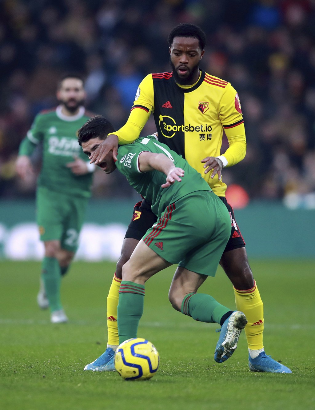 Wolverhampton Wanderers' Pedro Neto, foreground and Watford's Nathaniel Chalobah battle for the ball , during the English Premier League soccer match ...