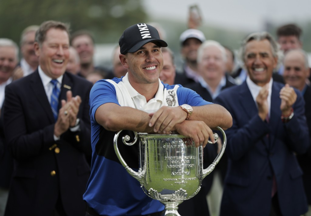 FILE - In this May 19, 2019, file photo, Brooks Koepka poses with the Wanamaker Trophy after winning the PGA Championship golf tournament at Bethpage ...