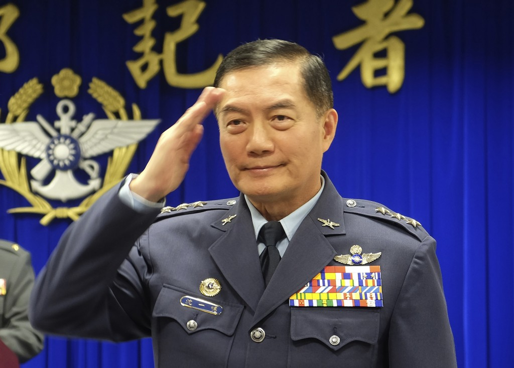 FILE - In this March 7, 2019, file photo, Taiwanese top military official Shen Yi-ming salutes as he is introduced to journalists during a press confe...